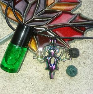 Jewelry - Rainbow metal bat essential oil diffuser necklace